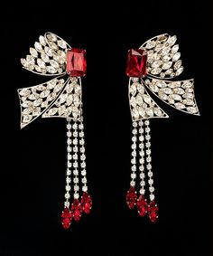 Yves Saint Laurent (French 1936-2008). Earrings, 1983-4. Glass, rhinestones, and metal. The Metropolitan Museum of Art, New York. Brooklyn Museum Costume Collection at The Metropolitan Museum of Art, Gift of the Brooklyn Museum, 2009; Gift of Yves Saint Laurent, 1987 (2009.300.2224a, b). #earrings #jewelry