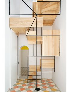 This staircase, which consists of platforms and wood boxes on a metal framework, connects two floors of a Sicilian fisherman's cottage remodeled by architect Francesco Librizzi.