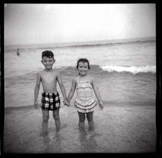 Bruce Springsteen and his sister Ginny hold hands at the Jersey Shore in 1955.