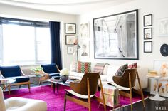 bright living room: magenta rug + navy blue chairs + white sofa | Song of Style