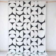 Spira Svante Black Swedish Fabric from Hus & Hem.   Björn Nilsson's stylish Svante fabric has a large semicircular monochrome design that will add a classic Scandinavian look to any room.  Spira fabrics are ideal for curtains, blinds, and soft furnishing projects.