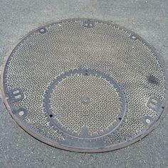 Parent and child manhole cover. Place: Inazawa city, Aichi, Japan.