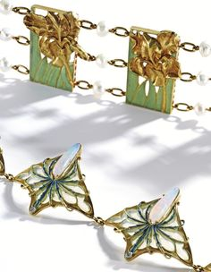 """DETAIL In the Salon of 1897, Lalique exhibited two pieces of jewelry designed with irises, a buckle and bracelet of enameled irises and opal, which he again displayed in the Exposition Universelle in 1900. A symbol of the Virgin in Medieval art, the iris featured prominently in Japanese art and was a favored motif of the pre-Raphaelite artists who held fast to the concept of """"memesis,"""" i.e. the imitation of nature as the main goal of art."""