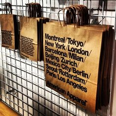 Time to shopping:) by Shin Kimura.  Some hanging shopping bags in one of our Japanese stores.  #AmericanApparel #shoppingbag #tokyo #japan