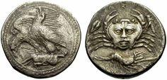 Rare Human-faced Crab Carapace on a Greek Drachm from Akragas (Sicily), c. 420 BC  The obverse shows two eagles perched on the carcass of a hare. This design may have been inspired by the omen presented to Agamemnon and Menelaus in Aeschylos' Agamemnon, where two eagles, representing the two kings, devoured a pregnant hare, an allusion to the city of Troy.
