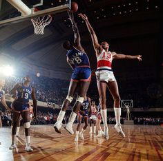 nice color photo! Knicks' Walt Bellamy blocks a shot by Sixers' Wilt Chamberlain (1966)
