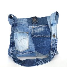 If you are looking for a roomy bag,this crossbody bag is one of the largest recycled bag in my shop.It is big enough to carry books,folders,tablet, and all your necessary items. I sewed several pieces of denim in different shades of blue together and shaped this bag.it has one exterior pocket and an original metal button,from waistband of a pant, keeps the top closed. This bag is lined with a red and white cotton print, and features 2 interior pockets.  Measurements: width: 15.5 (39.5cm)…