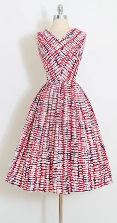 ➳ vintage 1950s dress * abstract print cotton in red, white and blue * v neckline * metal side zipper condition | excellent fits like medium length 45 bodice length 17 bust 38 waist 28 ➳ shop http://www.etsy.com/shop/millstreetvintage?ref=si_shop ➳ shop policies http://www.etsy.com/shop/millstreetvintage/policy twitter | MillStVintage facebook | millstreetvintage instagram | millstreetvintage 5879/1705