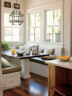 Kitchen nook with a booth - how lovely! I like the single pedestal that will support the table but not bump as many knees.
