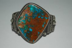 From my private collection: A very special bracelet... This is a stunning, large Red Mountain Turquoise, heavy and thick sterling hand wrought and stamped bracelet by Navajo Silversmith Freddie Maloney! Freddy Maloney is one of three brothers who make some truly outstanding Navajo sterling silver old style or vintage style jewelry. In an era when so many designs are prefabricated, Freddy and his brothers make each element by hand -- virtually unheard of today. This is another one of those…