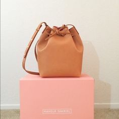 Mansur Gavriel Cammello Bucket Bag Sold out Italian vegetable tanned leather with rose interior. Comes with adjustable strap and detachable wallet. Made in Italy. Mansur Gavriel Bags Shoulder Bags