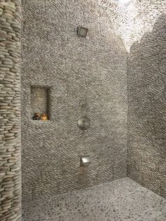 Contemporary wet room shower using standing java tan pebble tile on walls and traditional java tan pebble tile on shower floor. https://www.pebbletileshop.com/products/Java-Tan-Standing-Pebble-Tile.html#.ValqH_lViko