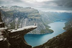Photographer Priscila Valentina hiked for 14 hours to Norway's Trolltunga for epic wedding portraits, all while carrying 35 pounds of camera gear!