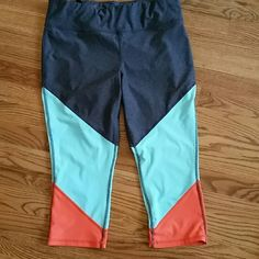 Xersion workout pants L Like new colorful workout pants. Drawstring waist with a seamline pocket to hold earphones, keys, etc. Worn 2x. Beautiful colors! Xersion Pants Capris