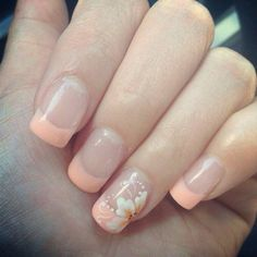 Soft coral French tips with a flower design #FrenchTipNails
