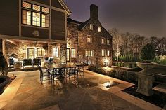 Glowing backyard patio lighting makes for cozy evenings at home.