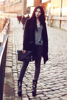 Black mini skirt, grey shirt, black blazer/black jacket, black tights, black boots