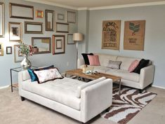 LOVE the simple wall decor in this living room - old coffee bean bags and an assortment of funky gilded frames!!