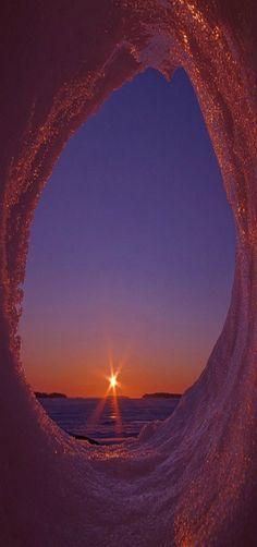 Sunrise in icy cave, Uutela, Helsinki, Uusimaa by Pete Huu