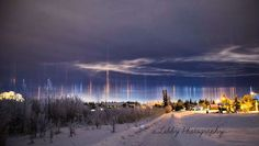 "Light pillar A light pillar is an atmospheric optical phenomenon, which is an interaction of light with ice crystals. When the temperature drops and these crystals position themselves horizontally as they fall through the air, they act as ""vessels"" for light, shooting it upwards."