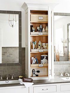 I love this tower storage unit in between a his and her sink in the bathroom!