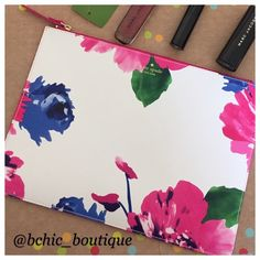 """Floral Kate Spade Clutch/ Pouch Brand New Leather Floral Print Kate Spade Pouch  Floral colors on white leather/ interior fuchsia color   Gold Zipper  Size 8"""" X 10""""   NO TRADES  Reasonable offers through the offer button only kate spade Bags Clutches & Wristlets"""