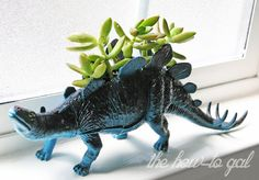 Use one of your kid's plastic dinosaurs to create a unique holder family members of all ages will enjoy.