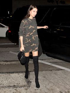 Camo sweatshirt dress with over-the-knee boots and a mini Alexander Wang bag.