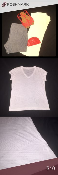 Chic white tee Comfortable and classic without sacrificing fashion. Semi sheer white shirt that can go with so many different things. From casual with shorts to work wear under a blazer. Excellent condition, no snags or stains. Bust is about 20 inches, from top of shoulder to hem is about 26 inches. 53 % cotton, 47 % polyester. Listing for shirt only. Shoes and bag sold in separate listing =) Liz Claiborne Tops Tees - Short Sleeve