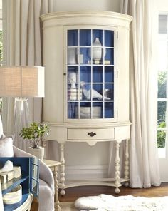 White cabinet with blue interior