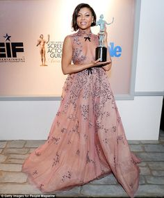 Gongs: The SAG Awards have been praised as seven out of 13 top honours were given to black...