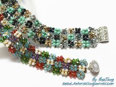Bracelet using RAW stitch. A lovely assortment of bicone crystals. Click on the image and then the album to see the photographed tutorial.