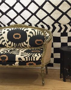 Madeline's 19th Century Settee in Black and Hazelnut Bara Ikat Fabric taken by Peter Wilds Design.