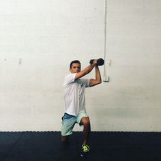 How to do a lunge woodchop: - Stand with your feet shoulder-width apart, holding a dumbbell in both hands on one side.  - Engage your core, keeping your back straight, and step forwards into a lunge – leading with the leg on the same side as you're holding the dumbbell.  - Bring the dumbbell up and across your body diagonally in the same movement as your lunge, keeping your knees and toes pointed forward.  - Reverse to the start.  - Complete all your reps on one side, then switch. Surf Training, Exercises, Workouts, One Sided, Lunges, Hold On, Surfing, Core, Health Fitness