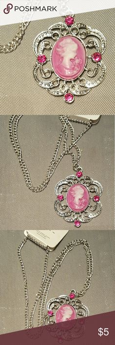 "28"" Pink Cameo Necklace You are looking at a beautiful silver tone Cameo Necklace, pink in color with accents of pink rhinestones Jewelry Necklaces"