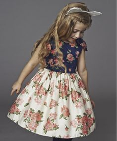 This adorable Baby K dress is perfect for parties and any other special occasions.