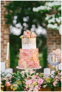 Wedding cake with gold, rose gold and lace details. Cake and florals by Love Is In The Air. Image by Sam Stroud Photography.