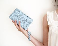 Hey, I found this really awesome Etsy listing at https://www.etsy.com/listing/107405445/icy-blue-rectangular-crochet-clutch-bag