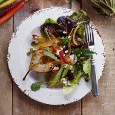 Roasting pears concentrates their flavor and brings out their sweetness. Paired with salty blue cheese and tart Champagne vinegar, they make a dramatic salad that highlights the fall fruit. If you'...