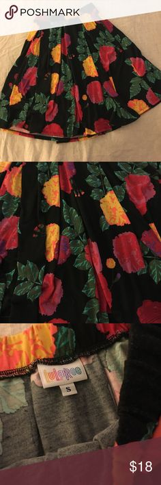 Loved LuLaRoe Madison Size small, well loved Madison. Black background, vibrant pinks, yellows, orange, and greens. Some fading. Some pilling near pockets. Still has a lot of life left in it. LuLaRoe Skirts