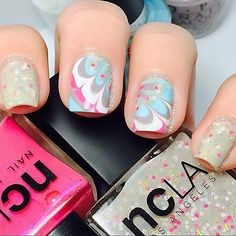1.NCLA One Upon A Time (multi-colored glitter confection) 2.NCLA Hills Bunny (pink) 3.Cuccio Breakfast in NYC (Light aqua blue) 4.Cuccio (Bright white opaque, french color) 5.OPI Taupe-Less Beach (Nudes/Neutrals)