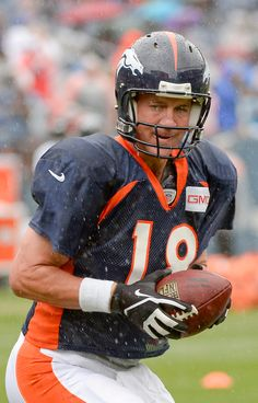 Peyton Manning. Training camp- 7/30/2014. I was there that day! It was a chilly 59 degrees and it poured off and on. Somehow, I didn't care! :)