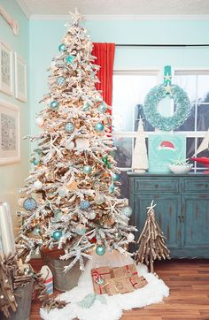 My Coastal Christmas - Treetopia Design Council 2016 I am SO excited to show off my coastal Christmas tree with everyone. I started working on my coastal tree a couple years ago. So this year I decided to go full force with it! Beach Christmas Trees, Coastal Christmas Decor, Nautical Christmas, Christmas Tree Design, Christmas Tree Themes, Christmas Home, Christmas Holidays, Christmas Wreaths, Christmas Crafts