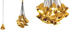 GIA Pendant - Imagine a gentle flower gracing your ceiling, the Gia pendant consist of a single hand sculpted polished brass callal illy tied by a simple string. LAMPS E14 1X Lamps (included). DIMENSIONS Dia. 20cm | 7,9'' H 200cm | 78,7'' (adjustable) WEIGHT 4Kg | 9Lb.