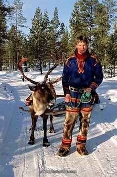 Sami costume: a northern Sami man, wearing reindeer leggings.