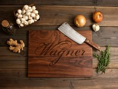 Personalized Engraved Wood Cutting Board - 12x16 - graphic family name - custom wedding or anniversary gift for foodie couple. $45.00, via Etsy.