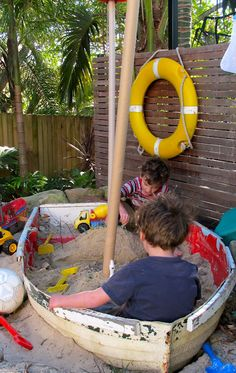 Boat for a sand box. ♥ Such a cute idea for a children's sandbox.  Ooh- What about a fountain or pond from an old dinghy.