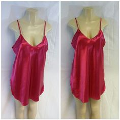 "LA INTIMATES, Pink Raspberry Chemise, Size Large LA INTIMATES, Pink Raspberry Chemise, Size Large, v-neck, shoulder straps sleeveless, slight curved shirt tail hem, side vents, silky slinky shiny, very feminine, machine washable, 100% polyester, 33"" length shoulder to hem, 20"" bust laying flat LA Intimates Intimates & Sleepwear Chemises & Slips"