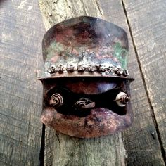 Primitive tribal anticlastic copper cuff with rhinestones and scorched leather