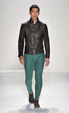Emerald pants and slim fitting leather jacket.